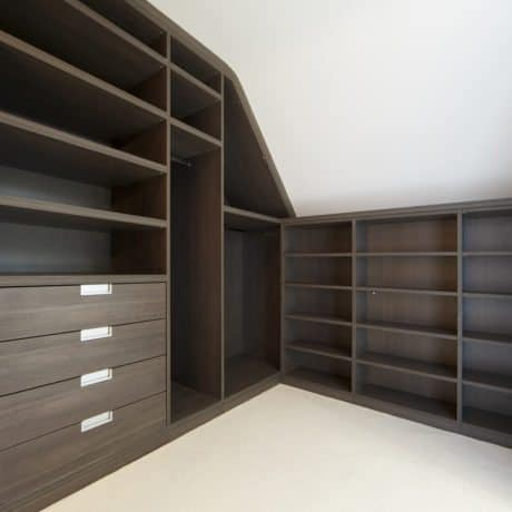 """a finely crafted wardrobe (part of a walk-in wardrobe in a luxury new penthouse apartment) made from dark walnut wood. Plenty of shelves and large drawers provide ample space for storing clothes, shoes and other garments.Looking for a Wardrobe image Then please see my other Wardrobe and Walk-in Wardrobe related images by clicking on the Lightbox link below...A>A"""