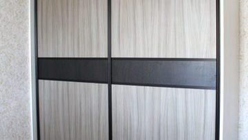 Wardrobe with sliding doors. Furniture. Interior design.
